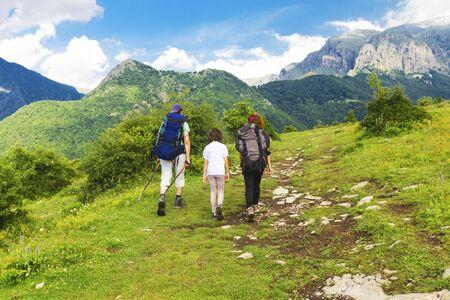Family tourists in the mountain Stock Photo
