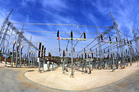 isolator switch: High voltage switchyard in electrical substation in fisheye perspective
