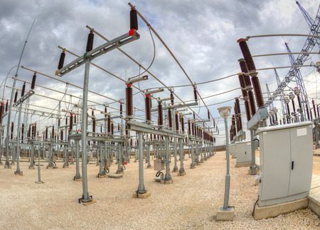 electric generating plant: High voltage switchyard in electrical substation in fisheye perspective
