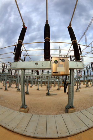 isolator insulator: High voltage switchyard in electrical substation in fisheye perspective