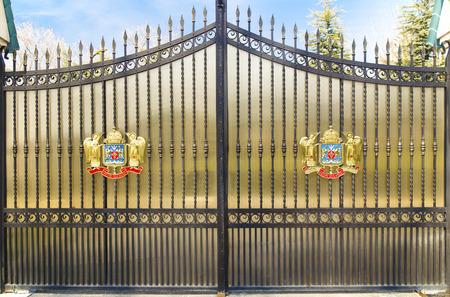 bucuresti: Metal door with Coat of Arms of Romanian Orthodox Church in Bucharest, Romania Stock Photo