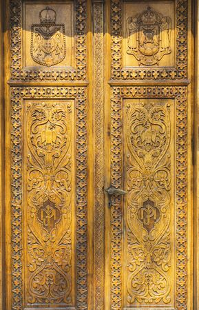 ornately: Beautiful ornately carved wooden door