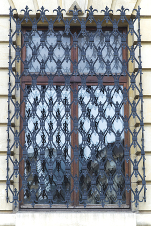 Window with decorative metal grid Stock Photo