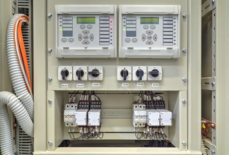Electrical control panel with electronic devices in modern electrical substation Stock Photo