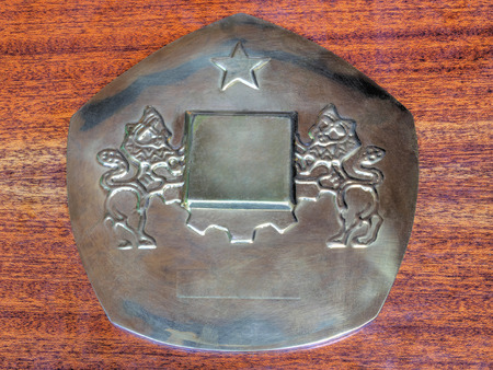 venerate: Metal plaque with two lions and a star