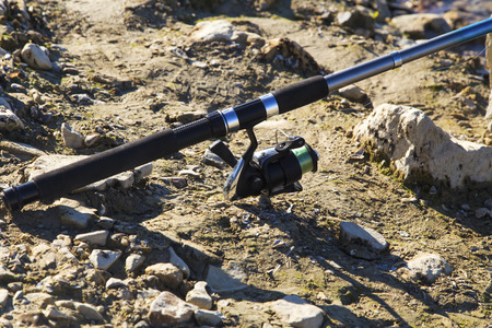 pisciculture: Fishing rod on the ground closeup