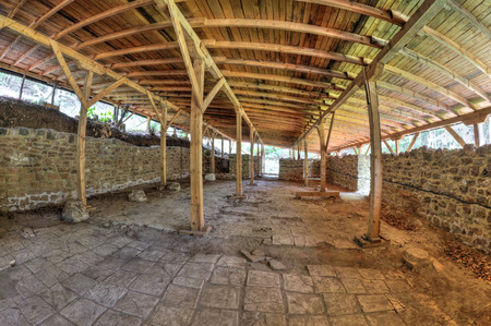 fisheye: Ruins of an ancient fortress covered with wooden roof in fish-eye perspective Stock Photo