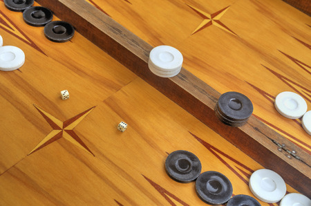 double the chances: Wooden board for playing backgammon game with pools and dice
