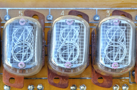 cathode: Electronic circuit board with old style indicator tubes closeup