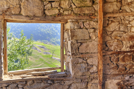 look through window: Look through window from abandoned stone house in the mountain