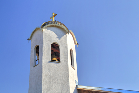church steeple: Church steeple with a cross in blue sky