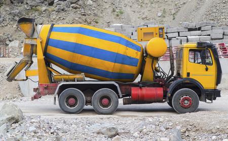 concrete mixer truck: Concrete mixer truck on construction site Stock Photo