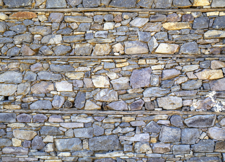 wooden beams: Stone wall background with wooden beams closeup