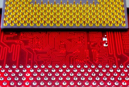 Technological background with red computer motherboard and central processing unit closeup Stock Photo