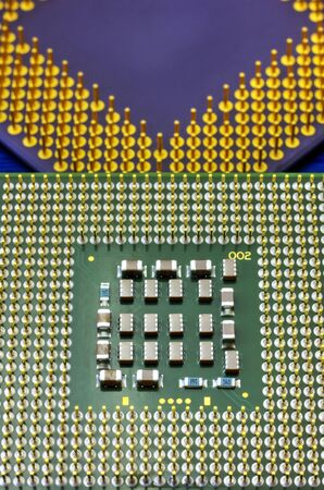 Technological background with computer motherboard and central processing units closeup