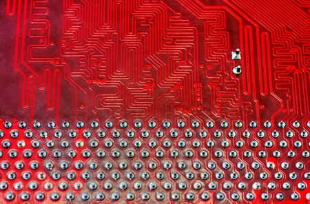 Technological background with red computer motherboard closeup