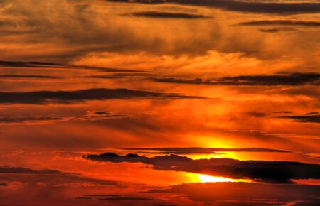 Beautiful sunset with dramatic clouds on the sky
