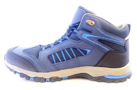 New trekking shoe isolated on white background closeup