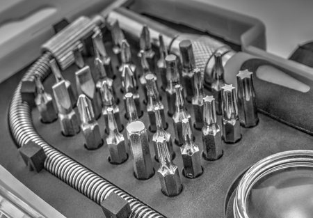 Mechanical bit tool set in black and white closeup Stock Photo