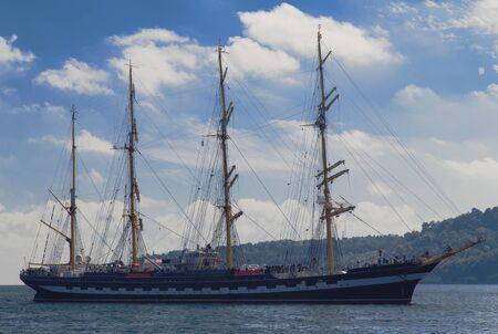 Sailing ship in the blue sea