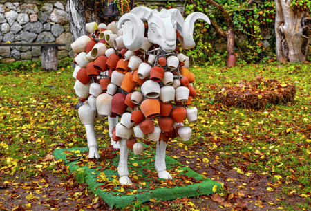 animal figurines: White sheep sculpture with beautiful decoration Stock Photo