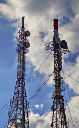 Communication antenna towers on blue sky