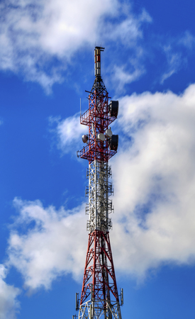 Communication antenna tower on blue sky Stock Photo