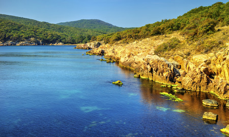 Beautiful landscape with rocky shore and blue sea Stock Photo