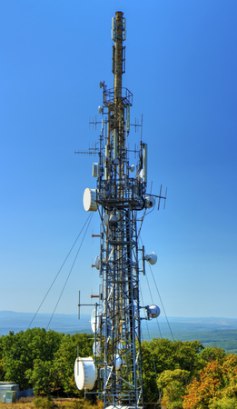 Communication antenna tower on blue sky Banco de Imagens