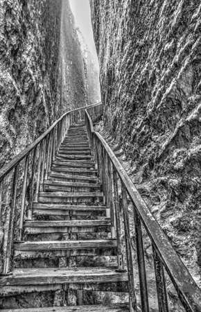 Beautiful view with stairs in the cave in black and white