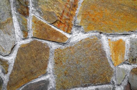 Colorful stone wall background close up view