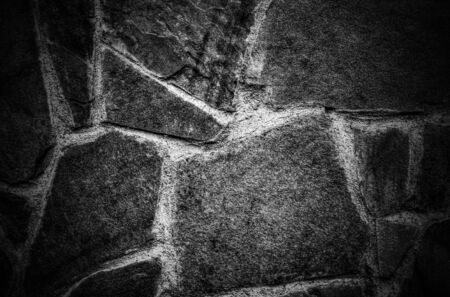 Stone wall background in black and white close up view