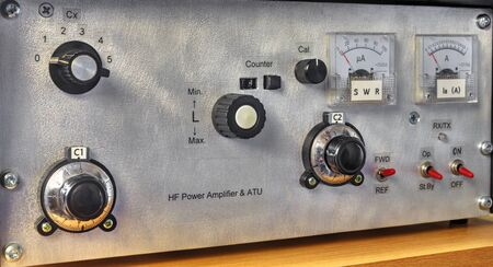 Front panel of a high frequency power amplifier with vacuum tubes close up view
