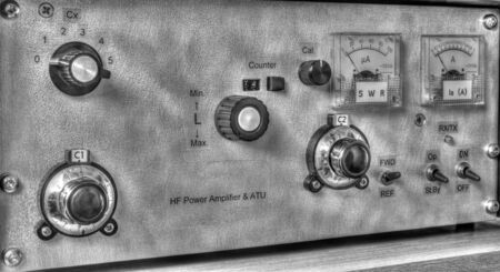 Front panel of a high frequency power amplifier with vacuum tubes in black and white Stock Photo