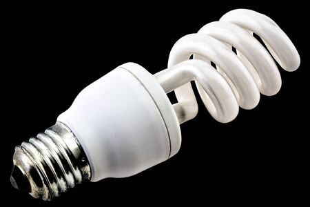 Energy saving bulb isolated on black background close up view