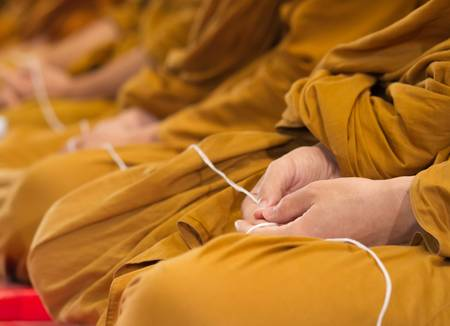 Thai bhuddhist monks are praying in a ceremony Stock Photo - 17089916