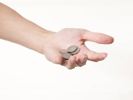 a male hand with coins on a white background Stock Photo