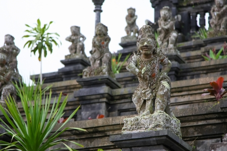Ancient god stone statue in Bali temp Indonesia Stock Photo - 17318090