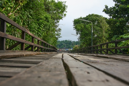 An old wooden bridge in Sangklaburi, Thailand photo