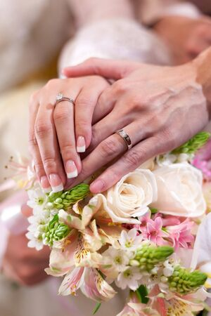 Sweet newly wed holding hands with their ring worn Stock Photo - 17467007