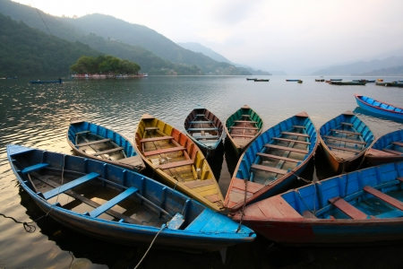 Colorful boats in Phewa lake in Twlilight, Nepal Stock Photo