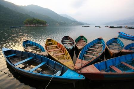 pokhara: Colorful boats in Phewa lake in Twlilight, Nepal Stock Photo