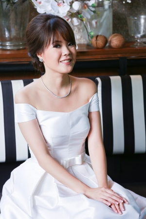 A beautiful young lady in wedding dress photo