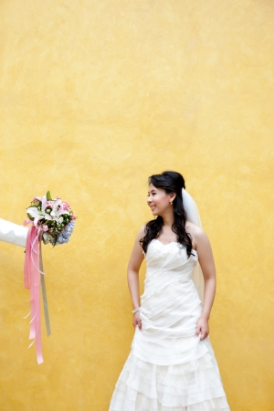 A young bride is offered  with a beautiful bouquet