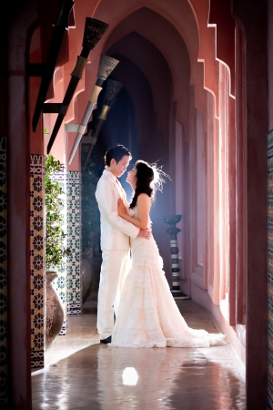 In love bride and groom are posing in romantic emotion