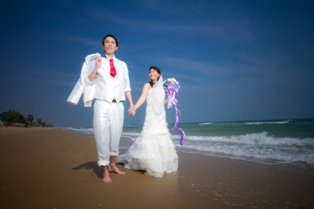 In love bride and groom are posing in romantic emotion photo