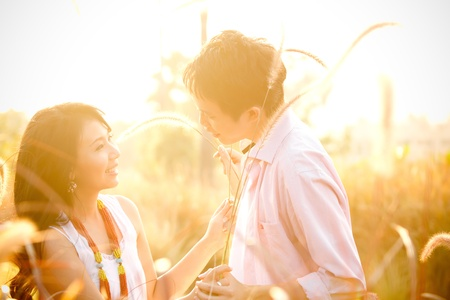 intentionally: An in love young couple playing with each others taken intentionally against the sunlight