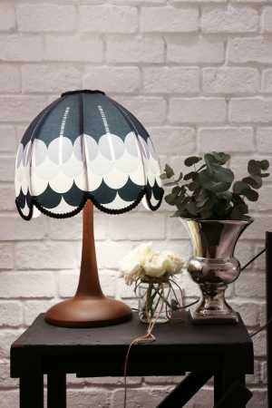 Vintage stylish lamp and white rose decoration with white brick wall