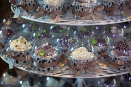 cakestand: Colourful cupcakes on cakestand in a wedding party