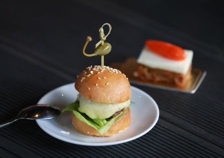 Delicious mini burger canapes on a white plate photo